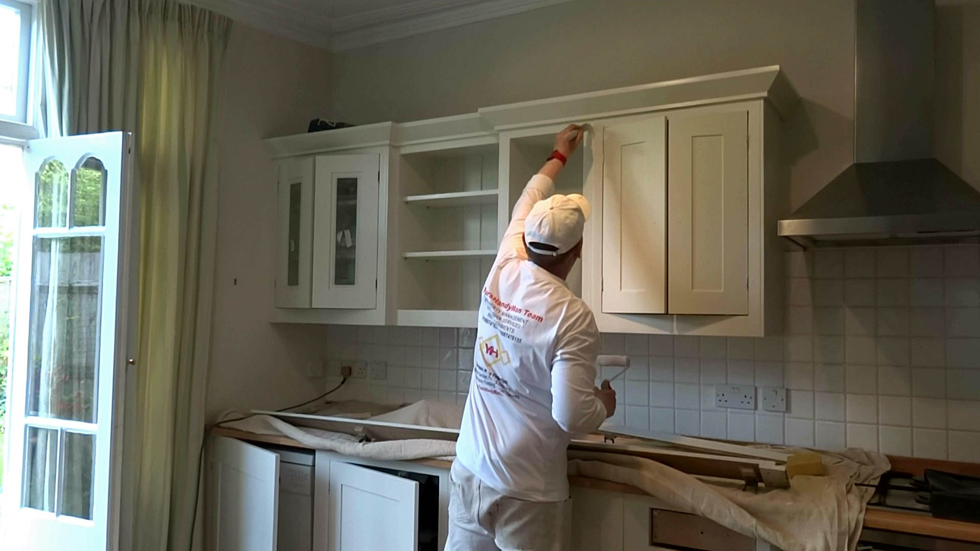 Kitchen cabinet painting- YoursHandyMan Team
